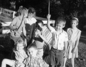 Off to play Pirates. Brother Peter brandishing a sword.  I'm the girl in the back with the bangs.