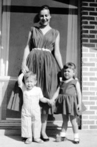 Mom and Peter and me.  Our matching dresses are red.