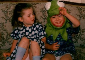 Will at about the age of his disappearance, wearing a Kermit the Frog head.  His twin Alice looks on, askance.