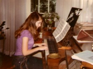 21 year old me appearing to play the piano.  The operative word is 'appear'.